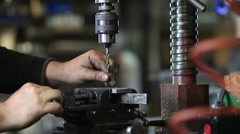 Drilling hole in iron piece with auger in workshop Stock Footage