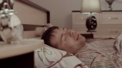 Sleeping handsome young man having a nightmare Arkistovideo