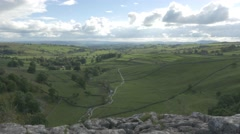4K Time Lapse View From Peak of Malham Cove Cliff Lime Stone Rocks Countryside Stock Footage