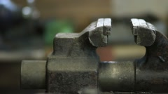 Old and rusty bench vise in metalwork workshop Stock Footage