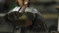 Worker fixing workpiece with clamp equipment Stock Footage