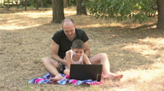 Father tickling son at the laptop Stock Footage
