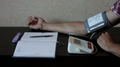 The doctor records the results of the tonometer in the magazine Stock Footage