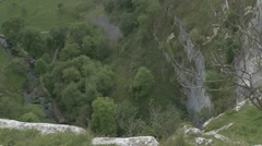 4K View Over Peak of Malham Cove Cliff Lime Stone Rocks Trees Stock Footage