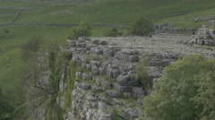 4K People on Peak of Malham Cove Cliff Lime Stone Rocks View Over Countryside Stock Footage