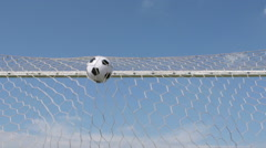 SLOW MOTION: Soccer ball flies into a gate (bottom view) Stock Footage