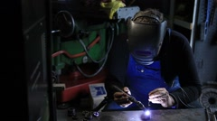 Welder man Tig welding in workshop Stock Footage