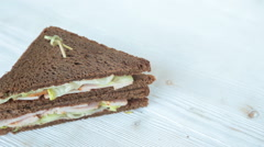 Sandwich on wooden table Stock Footage