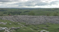 4K Peak of Malham Cove Cliff Lime Stone Rocks View Over Countryside Trees Stock Footage