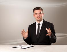 Televison host in live show with blank background Stock Photos