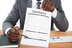 Businessman showing insurance document Stock Photos