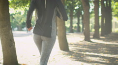 Follow Shot of Woman Running in Park at Bright Sunny Day. Stock Footage