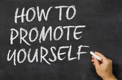 How to promote yourself written on a blackboard Stock Photos
