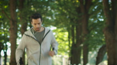 Tired Male Jogger Stopped to Catch his Breath During Morning Run. Stock Footage