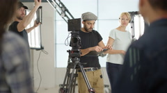 4K Behind the scenes with TV or film  production crew working together on set Stock Footage