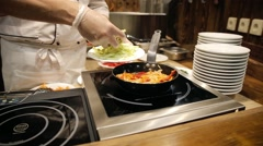Pasta cooking roast vegetables in a pan in a restaurant Stock Footage