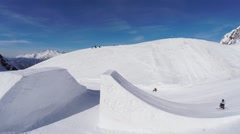Quadrocopter shoot skier jump from springboard, make flips in air. Snow mountain Stock Footage