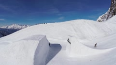 Quadrocopter shoot snowboarder jump from springboard. Snowy mountain. Ski resort Stock Footage