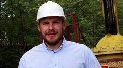 Engineer in a white helmet smiling Stock Footage