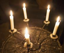 Candles in a candelabrum Stock Photos