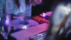 Girl and man dj spinning at turntable on party in nightclub. Lights. Dance Stock Footage