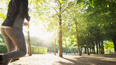 Young Woman and Man Running Together Forward Outwards Camera in Bright Sunny Day Stock Footage