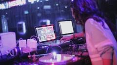 Girl dj spinning at turntable on party in nightclub. Spotlights. Dancer. Cheer Stock Footage