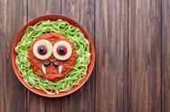 Green spaghetti pasta spooky halloween vegetarian food vampire monster Stock Photos