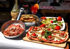 Tasted and famous Italian food Stock Photos