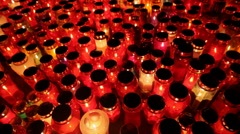 Thousands of Candles illuminating a cemetery during  All Saint's Day Stock Footage