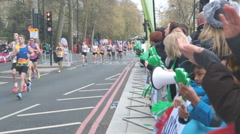 4Runners in the 2016 London Marathon being cheered on by the crowd - Editorial Stock Footage