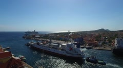 Aerial of containership leaving harbor of Curacao Stock Footage