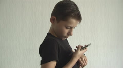 Young boy checking his  for the time on his wrist watch. Stock Footage