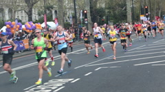Runners in the 2016 London Marathon being cheered on by the crowd - Editorial Stock Footage
