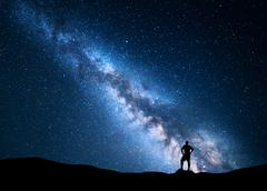 Milky Way and silhouette of alone man. Night landscape Stock Photos