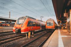 High speed red commuter trains at the railway station Kuvituskuvat