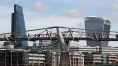 Millennium Bridge with  Leadenhall Building and 20 Fenchurch Street, London Stock Footage