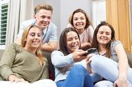 Group Of teenage Friends Watching Television At Home Stock Photos