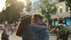 Guy circling woman in the city Stock Footage