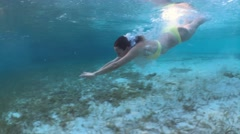 Woman dives and swims underwater, Exuma, Bahamas Stock Footage