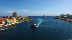 Aerial of tugboat returning back into the harbor of Curacao Stock Footage