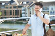 Young Man Making Phone Call On Mobile Phone Walking To Work Stock Photos