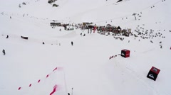 Quadrocopter shoot skier make jump from springboard, flip in air. Ski resort Stock Footage