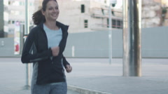 Woman Running Outdoors in Urban Environment Arkistovideo