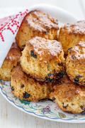 Homemade scones with dried berries and white napkin. Stock Photos