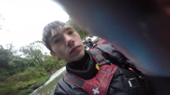 Portrait of a man kayaker on a river, slow motion. Stock Footage