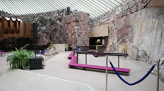 Stage, altar and pipe organ are in light hall of Finnish Church of the Rock Arkistovideo