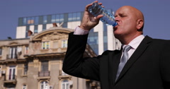Businessman Drink Water and Wait Associate Meeting Downtown City Center Street Stock Footage