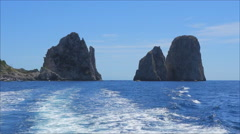 Amazing view on the Faraglioni rocks and Mediterranian sea in Capri, Italy  Stock Footage