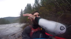 Portrait of a man with a beard kayaker on a river, slow motion. Stock Footage